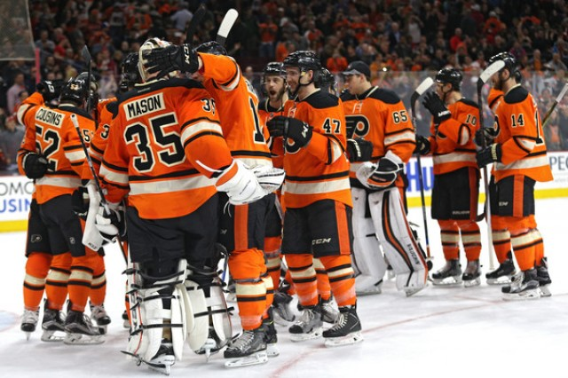 Philadelphia-Flyers-celebrate-on-the-ice-after-beating-the-Washington-Capitals-640x426.jpg